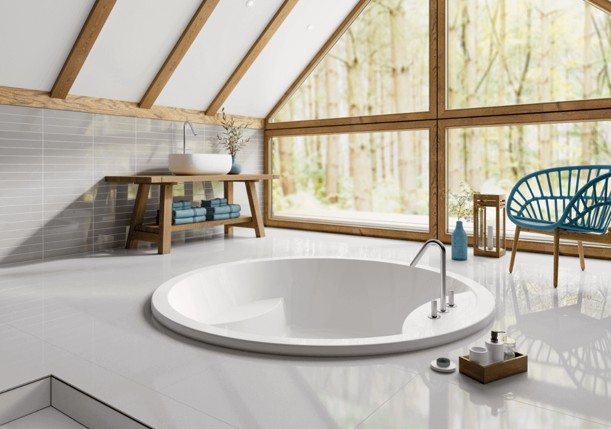 Oasis Inset bath in a white bathroom with large window